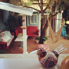 Back patio love, note the red/white/blue and hammock.  Photo by kellyraeroberts