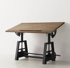 RH TEEN's Draftsman's Desk:Inspired by the classic angled drafting table, our industrial-inspired hardwood desk can be adjusted for height and tilt, allowing you to work sitting or standing at your preferred angle.