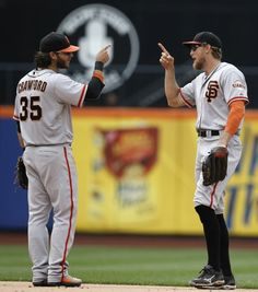 Shortstop Brandon Crawford greets right fielder Hunter Pence after the Giants' 9-0 shutout of the New York Mets on Aug. 3.