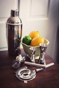 citrus in a bowl with bar tools