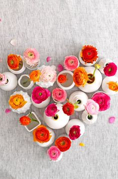 Love overhead shot, mix of flower colours and different vase shapes.