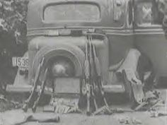 Some of the belongs of Bonnie and Clyde taken out and laid against their car after ambush & they were both killed.