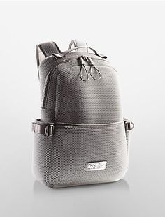 A performance backpack constructed of lightweight nylon mesh and neoprene fabrics trimmed with brushed nickel hardware finish.
