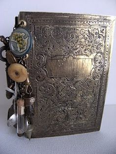 This is a metal etched cover. Her web site is wonderful if you love the old distressed stuff!