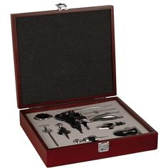 """Size: 2-1/2""""H x 10""""W x 8-1/4""""L Ergonomic Bottle Opener Foil Seal Cutter Drip Ring Thermometer Pourer Two Wine Stoppers Stainless Spouts Two Replacement Corkscrew Bits Fine wine connoisseurs will appreciate the elegance and distinction of our Wine Accessories in Deluxe Mahogany Wood Box. This remarkably refined gift features 7 wine accessories housed in a stunning mahogany wood gift box. The box features a smooth silver plate that can be personalized in one of three font styles to accentuate…"""