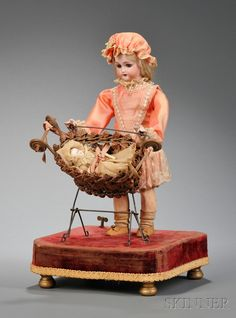 MECHANICAL LADY ROCKING BABY IN CRADLE ~ Roullet & Decamps, Simon Halbig rocking basket w/all-bisque baby, on velvet covered platform, c.1910.