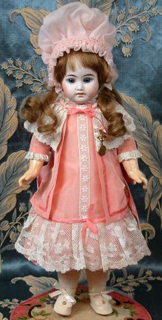 """Sweet Cabinet Sized Fleischmann & Bloedel French Bebe 15.5"""" Bisque Doll w/Human Hair Wig! We all have a sweet spot for pale-faced, blue-eyed French dolls, there's no use in denying it! This beauty stands at a petite 15.5"""" tall, with her original French body, and a beautiful bisque head with a gorgeous, innocent complexion. 