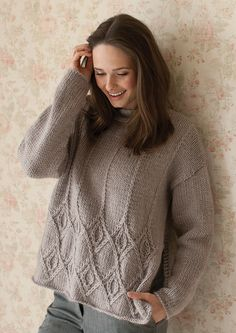 Kay | Using Cocoon, a super soft blend of 80% wool and 20% mohair, this comfy sweater was designed by Georgia Farrell. This drop shoulder sweater features a lovely slip stitch cable pattern at the bottom half of the jumper.