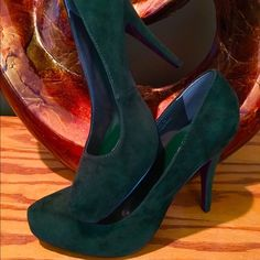 Green suede pumps! Classy yet exotic olive green suede heel. Rock these with your favorite boot cut jeans or slim fitted legging. Heel height 4.75; pointed toe; synthetic suede. Never worn. (Purse pictured not included) Shiekh Shoes Heels