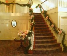 """White and pink floral garland on the main entrance stairs as featured on the 1800Flowers' flower blog, Petal Talk post, """"It's a Nice Day for a White Wedding' with White Wedding Flowers."""""""