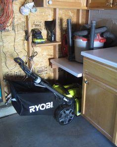 My lawn mower / shop vac storage solution - go vertical and create a lawn mower garage.