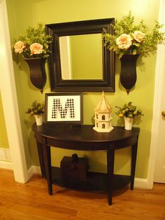 Love this for the front foyer! Like the idea of having decor on each side of mirror