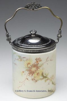 Mt Washington Biscuit Jar with Floral Decoration. 5 Inch HOA and 4 1/4 Inch DOA. Signed MW in Lid.