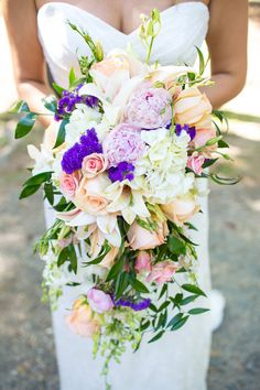 Kearston & Amon Photos by Kendal Dockery Photography  ||  Beautiful & Fresh Cascade Wedding Bouquet Arranged With: White Lilies, White Hydrangea, Purple Statice, Peach Lilies, Peach Roses, Pink Roses, Pink Spray Roses + Several Varieties Of Greenery/Foliage^^^^