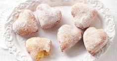 Share the love with these little custard-filled doughnuts.