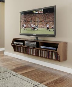 mounted floating shelf and tv-- I'd want this shelf in black or in a pop accent color coordinated with the room.