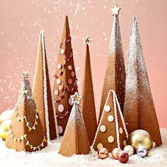 Gingerbread Trees - Every homemade gingerbread house deserves a dazzling display of Christmas trees. Decorate these easy-to-assemble gingerbread cookie trees to your heart's desire with our quick icing recipe, powdered sugar, and pastel candies. Christmas Gingerbread House, Christmas Sweets, Christmas Cooking, Noel Christmas, Christmas Goodies, Winter Christmas, Gingerbread Cookies, Christmas Crafts, Christmas Decorations