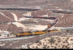shot of two trains pulled by UP resp. BNSF locos -- but count the number of tracks!