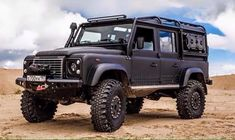 Nicley kitted Defender 110. Crazy ground clearance for rock climbing