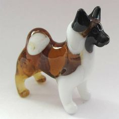 This is Japanese Akita Inu glass figurine which is made for special collection of dog figurines. The figurine if made very realistically. It is hand-created by Russian artist in art studio of St.Petersburg