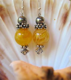Yellow glass beaded earrings with silver beads and ear wires