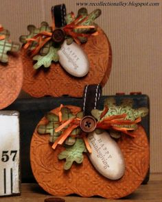 By Janea. She used a Cricut to cut the pumpkin and leaves, but I would handcut the pumpkin and maybe the leaves too. Pumpkin is dry embossed. Leaves are stamped with text or pattern stamps. Everything is sponged on the edges with vintage photo Distress ink. Pumpkin stem is a ribbon. Add button and raffia to embellish.