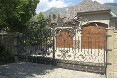 da Vinci Details Iron Gate. With faux painted garage doors behind.   www.davincidetails.com