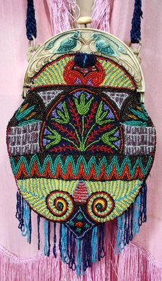 Art Deco beaded bag, celluloid frame with birds, beadwork features lotus flowers, 1920's, Egyptian Revival