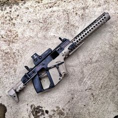 This is an amazing customized Kriss Vector submachine gun, though it looks a bit more like an assault rifle here, with its extended barrel, and guard. Military Weapons, Weapons Guns, Airsoft Guns, Guns And Ammo, Military Life, Paintball Guns, Kriss Vector, Vector 45, Submachine Gun