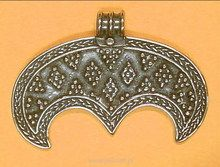 Lunula is a crescent moon shaped charm, found in ancient Slavic and Norse cultures. It is a pagan symbol of the moon, magick and femininity, worn only by women.