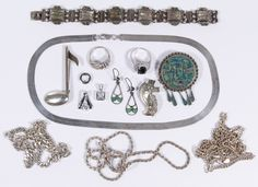 Lot 564: Sterling Silver Jewelry Assortment; Including four necklaces, a bracelet, a pair of earrings, three pendants, two rings, two pins and a convertible pin/pendant; some signed