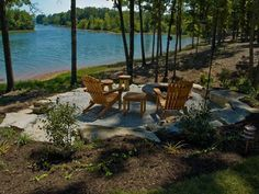 A small patio sits off the shore of Watts Bar Lake. Seating options and a fire pit take the entertaining from the deck to the water. Fire Pit Area, Patio Bar, Fire Pit Backyard, Backyard Patio, Fire Pits, Patio Table, Lake Landscaping, Landscaping Ideas, Lakeside Living