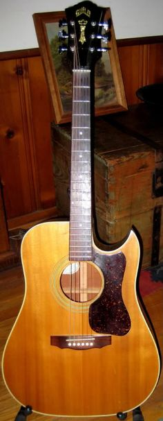 My Guild D-40C before a three-year old accidently put her foot thru the body a few years ago. Purchased at Ed's Guitars in 1988 for 800 bucks. Still my favorite guitar Guild Guitars, Much Music, Three Year Olds, Acoustic Guitar, Ukulele, Music Instruments, Age, Musica, Guitars