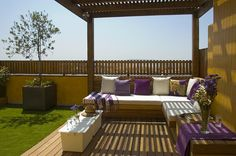 Roof-deck with artificial turf.  Love the purple.  It's unexpected and really adds punch.