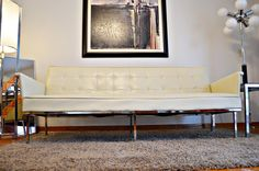 Gorgeous creamy off white vintage naugahyde and chrome sofa. Single continuous cushions on both the sofa back and seat with button tufting