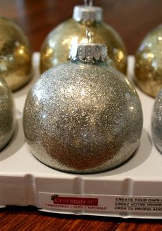 DIY Glitter Ornaments!!! (Glitter's on the INSIDE!) All you need are: Glass Ornaments, Mop & Glo (or any kind of floor wax), a funnel, Q-Tips & good  glitter!  Just imagine all the colors of glitter you could use to match a color theme!!! Lee and Becky: Christmas Craft: Glitter Ornaments