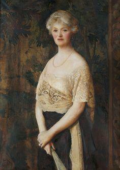 Frank Cadogan Cowper (British, 1877-1958), Portrait, three quarter length of Mrs E.H. Evans-Combe wearing evening dress, 1920.