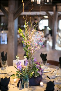 purple wild flower centerpieces, simple elegance at The Lake House at The Windmill Winery