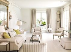 Tone on Tone, neutral living room with linen drapes and great occasional chairs.
