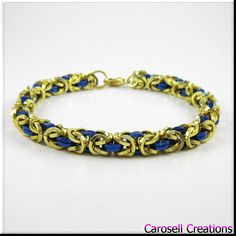 Chainmaille Bracelet Blue and Gold Square Cut Byzantine Chain Mail TAGS - Jewelry, Bracelet, Chain Bracelet, Link Bracelet, carosell creations, aluminum bracelet, chain link bracelet, byzantine bracelet, chainmaille bracelet, chain maille jewelry, chain mail bracelet, mens bracelet, hand woven bracelet, blue bracelet, blue anklet, blue and gold, jump ring bracelet, etsy, handmade