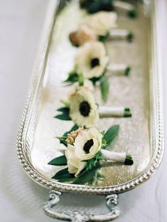 super sweet boutonnieres for the groom and groomsmen! white anemones! and what a lovely photo for your wedding album!
