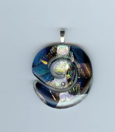 Swirl fused glass pendant that I fused then cut out with a ringsaw then fire polished.  One of my favs that I sold.