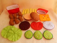 Felt hamburger set. Hamburger with fries and chicken nuggets - play food set. A great gift for children. The set consists of 25 parts: Hamburger bun - consists of 2 parts 2 lettuce 3 cucumber slices 1 cheese slice 1 tomato slice 1 onion slice 1 grilled cutlet 6 French fries 1 Box for