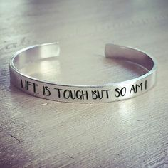 Life is tough, but don't let it get you down. Make a statement with this beautiful custom bracelet. It serves as an every day reminder that you are stronger than you think. Bracelets Type: Cuff Fine or Fashion: FashionMaterial: Stainless Steel Cute Jewelry, Metal Jewelry, Jewelry Crafts, Jewelry Accessories, Unique Jewelry, Life Is Tough, Homemade Jewelry, Hand Stamped Jewelry, Metal Stamping