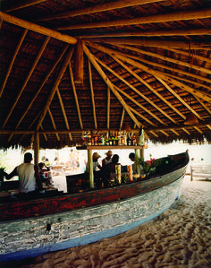 Fishing boat turned bar under traditional thatch roof at the Uxua Casa Hotel - UXUA Casa Hotel features ten unique casas which blend seamlessly into the historic center of Trancoso, a small fishing village on Brazil's idyllic southern Bahian coast.    Four casas are restored fishermen homes on the 16th century town green called the Quadrado, while six others sit in a lush garden... ~ OMG this place looks awesome! I want to go now!!