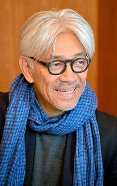 "Musician Ryuichi Sakamoto to release single in effort to block U.S. base project in Okinawa: In the Okinawa dialect, ""Miruku Yugafu"" means a peaceful and affluent world brought about by the Miruku deity. The song is about how precious people's lives are. ""If the song is sung, it gains power,"" he said. ""I was not thinking about arranging it in a way to make it sound like an Okinawan musical scale, but it is fascinating that it sounds like a piece passed down from the Ryukyu Kingdom."""