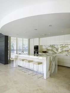 Traralgon - Calacatta Oro marble features predominantly in this beautiful classic modern kitchen design.