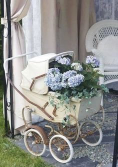 Oh how I love this vintage baby carriage filled with hydrangea and ivy. So beautiful and shabby. Hydrangea Garden, Blue Hydrangea, Vintage Pram, Baby Buggy, Baby Carriage, Baby Boy Shower, Baby Showers, Garden Art, Garden Ideas