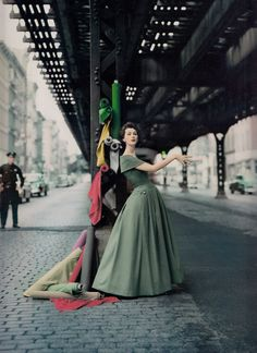 "Model DOVIMA (appeared in Funny Face as loopy model) 'Under the El' ""Dior creates cosmopolitan drama"" 1956 for Douglas Simon. Photo by WILLIAM HELBURN from his book 'Midcentury Fashion & Advertising Photography' (minkshmink)"