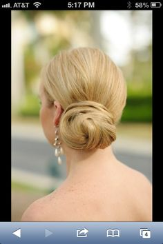 an elegant low chignon to the side: simple and sophisticated